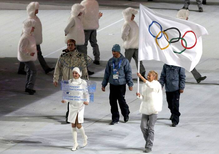 "The Indian athletes will compete under the ""independent athletes"" category and will be represented under the Olympic flag.<br /> Independent participants enter the arena during the opening ceremony of the 2014 Sochi Winter Olympics. (Reuters)"