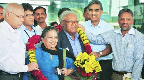Bharat Ratna C N R Rao and wife Indumathi being welcomed at the Kempegowda international airport in Bangalore Wednesday.