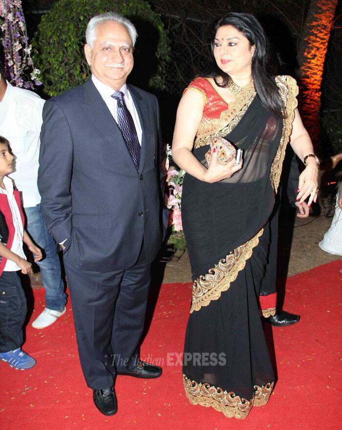 Director Ramesh Sippy smiles for the bugs while his wife Kiran Juneja looks nice in a black and gold sari. (Photo: Varinder Chawla)
