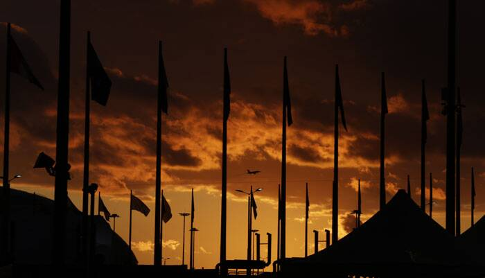The sun sets over Olympic Park ahead of the 2014 Winter Olympics. (AP)