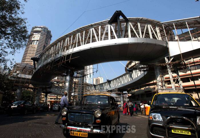 The skywalk structure, touted by the MSRDC as 'unique in the country,' is all set to represent the latest innovations in architecture, with a 510 metre long walkway supported by stress rods suspended from a central tower, replete with four escalators and fancy LED lights. (IE Photo: Vasant Prabhu)