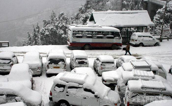 Himachal Pradesh's popular tourist destinations Shimla and Manali on Saturday received more snow, giving them a picturesque look. (IE Photo: Lalit Kumar)