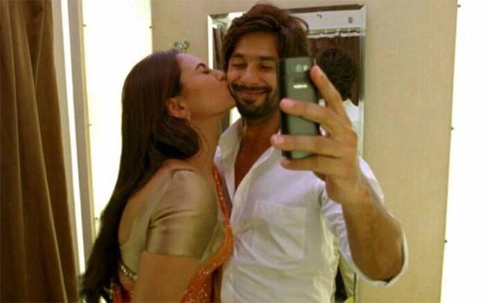 Stories about 'R… Rajkumar' co-stars Shahid Kapoor and Sonakshi Sinha have been doing the rounds for sometime now. Shahid and Sonkashi met on the sets of action flick and hit it off immediately, reportedly having a blast during the film's promotions. <br />The rumoured love-birds were next seen together on Karan Johar's controversial chat show, 'Koffee With Karan' and seemed more than just comfortable in each other's presence. And this selfie we laid our hands on - which has Sonakshi Sinha kissing her 'Rajkumar' - says a lot about this growing 'friendship.' Are Sonakshi and Shahid the new love birds of Bollywood.
