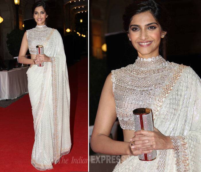 Sonam Kapoor opted for a shimmering white sari for the evening with a studded high neck blouse. She finished off her look with simple diamond studs and light make up. We like! (Photo: Varinder Chawla)