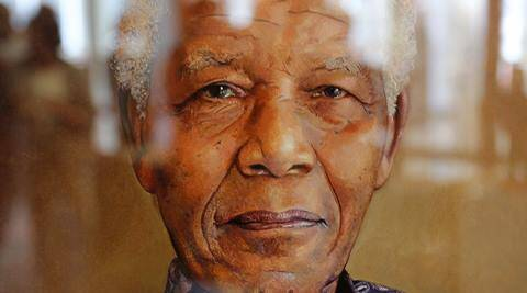 A reflection is seen on a painting of former South African president Nelson Mandela by British artist Richard Stone, at a art exhibition in his honor at Cape Town. Twenty two artists paid tribute to Nelson Mandela, creating art accessible to a wide audience.(AP photos)