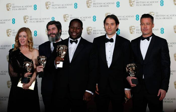 Steve McQueen poses for a group picture with fellow BAFTA winners and Brad Pitt. (Reuters)