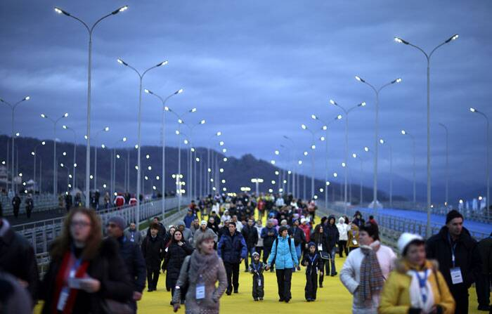Spectators arrive for the rehearsal of the opening ceremony at the 2014 Winter Olympics. (AP)