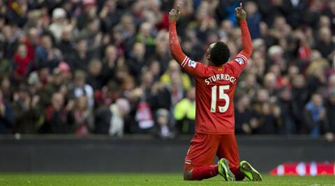 Liverpool's Daniel Sturridge celebrates after scoring his second goal against Swansea City during their English Premier League soccer match at Anfield Stadium, Liverpool.