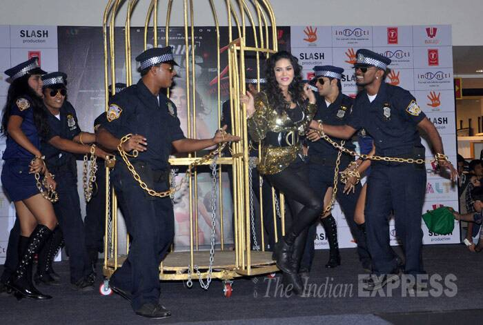 Sunny Leone looks sexy in black jeggings and blingy gold jacket. She finished off her look with a clunky waist belt and necklace. (Photo: Varinder Chawla)
