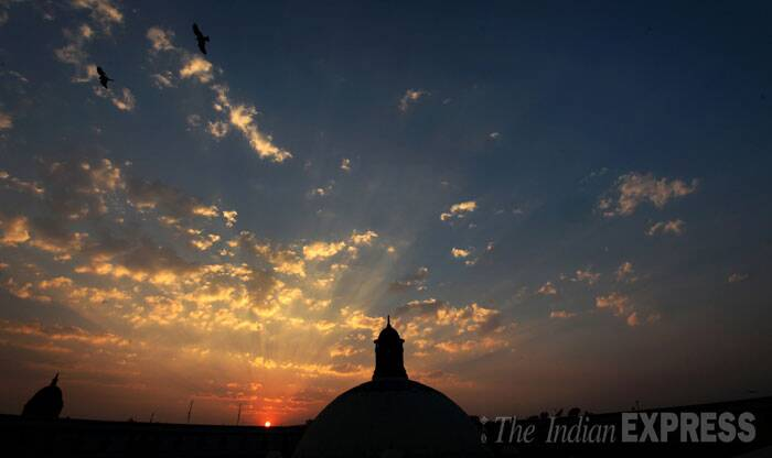 The sun sets over the central dome of the Parliament as the last session of the current Lok Sabha comes to an end on Friday. (IE Photo: Neeraj Priyadarshi)