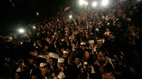 Followers of Arvind Kejriwal at AAP office in Connaught Place in New Delhi on Friday. (Praveen Khanna)