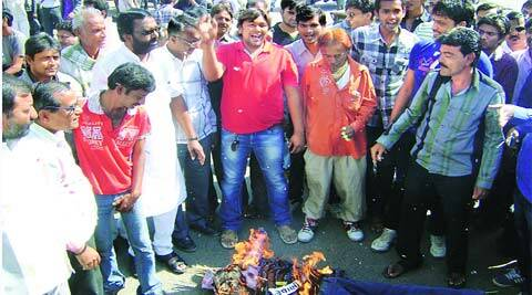 Kalu Pansuriya and his supporters burn Vijay Rupani's effigy in Amreli Wednesday. (Express)