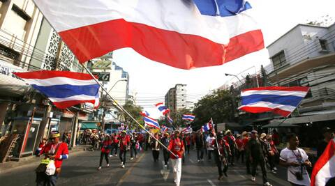 Anti-government protesters march through the streets of the Chinatown area of Bangkok, Thailand. (Photo: AP)