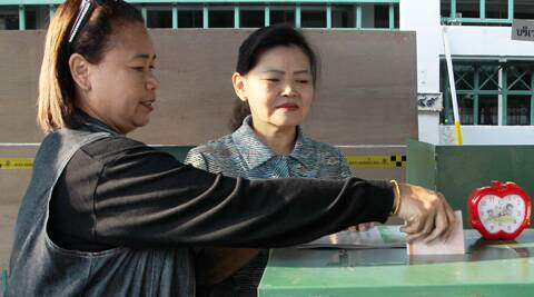 A Thai woman casts her vote during the general election at a polling station in Bangkok, Thailand on Sunday. (Photo: AP)