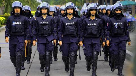 Thai policewomen march while guarding the Command Management for Peace and Order. (AP)