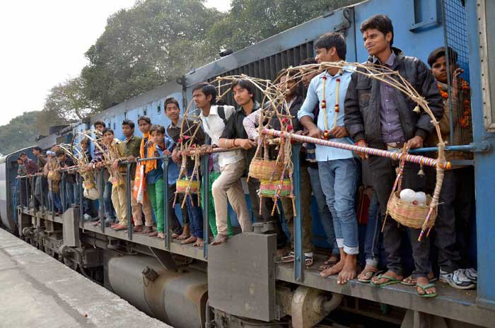Devotees travel by train to fetch Ganga water for 'jalabhishek' of Lord Shiva on Shivratri at Chandause in Sambhal district. (PTI)