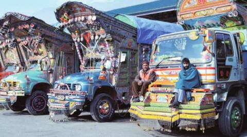 Stranded Pakistani drivers sitting on their trucks at Salamabad Trade Center in Uri, Jammu and Kashmir, on Wednesday. (PTI)