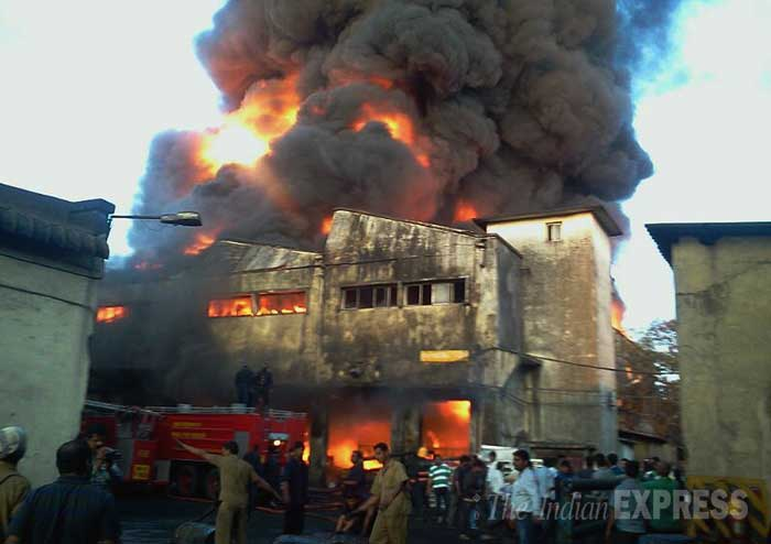 Firemen try to douse the fire at the tyre factory. (IE Photo: Pradip Das)