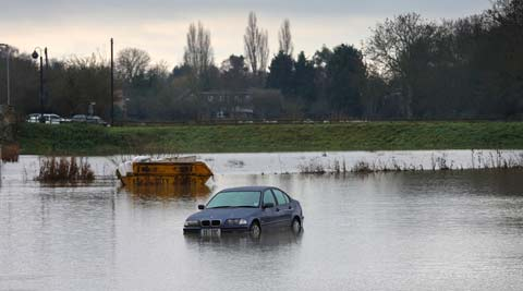 The River Thames has burst its banks after reaching its highest level in years. (AP)