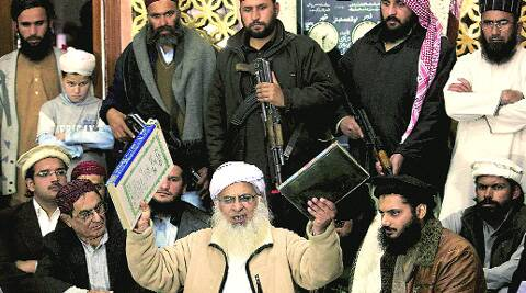 Lal Masjid cleric Maulana Abdul Aziz, a member of the Taliban team, at a news conference in Islamabad Friday. (AP)