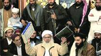 Lal Masjid cleric Maulana Abdul Aziz, a member of the Taliban team, at a news conference in Islamabad Friday. 	(AP)