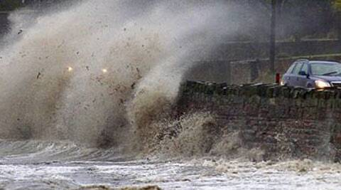 Strong winds and high tides batter the coastal road close to Newtownards, Northern Ireland (REUTERS)