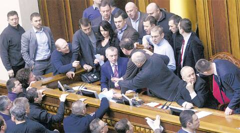 Ukrainian deputies argue near Speaker Volodymyr Rybak (2nd R) during a session of parliament in Kiev Friday. REUTERS