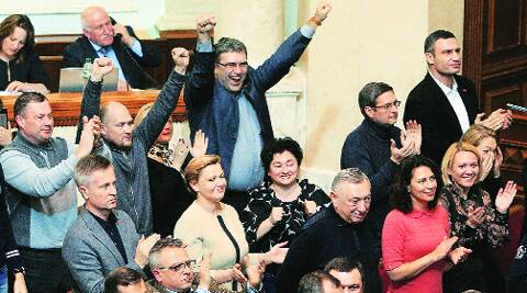 Opposition members celebrate Yanukovych's removal. (AP)