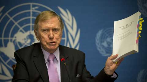 Retired Australian judge Michael Kirby, chairperson of the commission of Inquiry on Human Rights in the Democratic People's Republic of Korea, shows the commission's report during a press conference at the United Nations in Geneva, Switzerland. (AP)