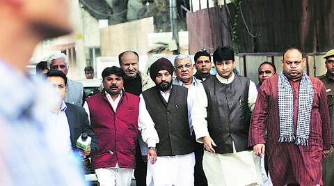 Congress leaders on their way to meet Lt-Governor Najeeb Jung on Friday.
