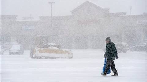 The sloppy mix of snow and face-stinging sleet closed schools and businesses. (AP)