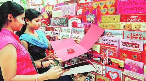 Girls purchase Valentine's Day cards at Malleshwaram in Bangalore Thursday. www.pics4news.com