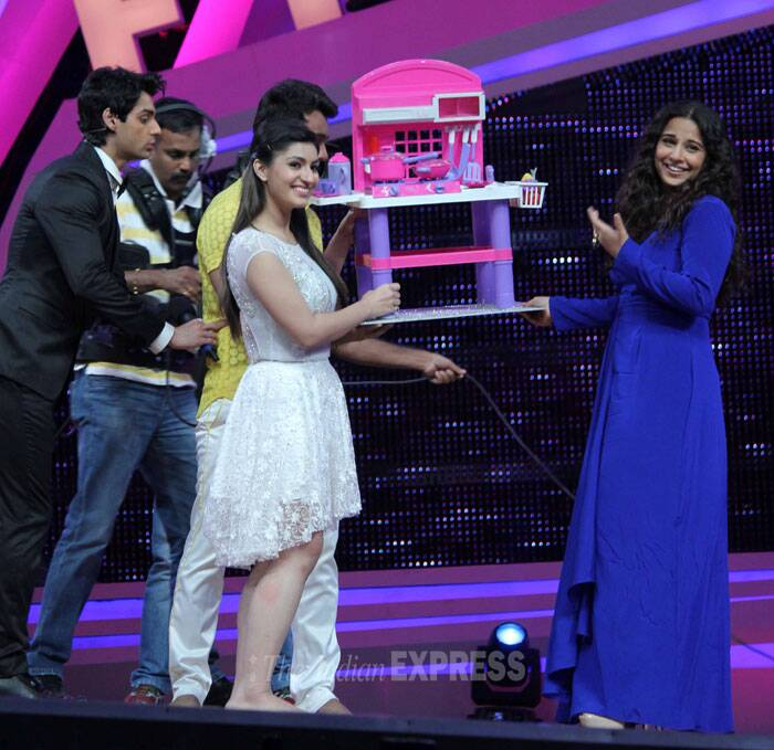 Vidya is quite tickled with her special gift – a toy kitchen set! (Photo: Varinder Chawla)