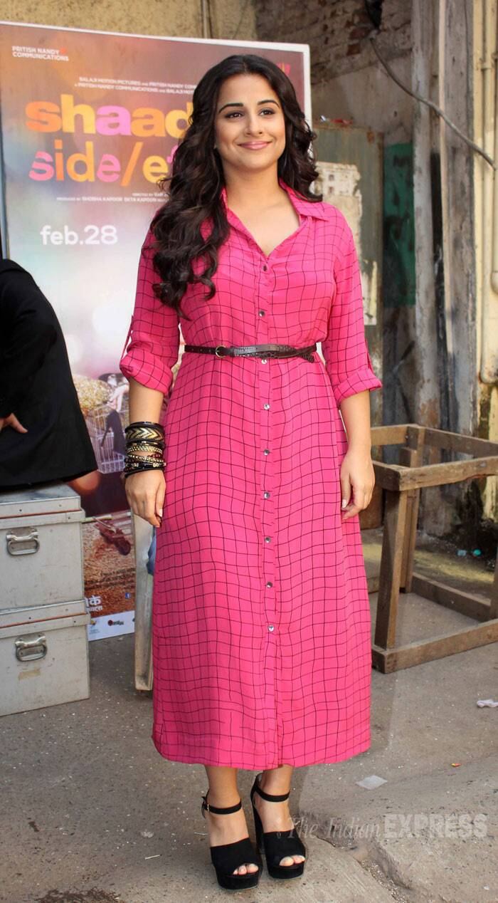 Vidya Balan, who is going to be seen opposite Farhan Akhtar in the film, was later spotted in a pink checked belted dress. (Photo: Varinder Chawla)