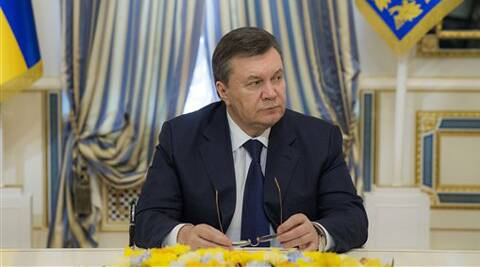 Ukrainian President Viktor Yanukovych attends the signing of an agreement to end the Ukrainian crisis in Kiev, Ukraine, Friday, Feb. 21, 2014.