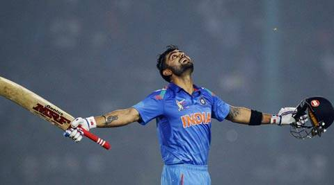 Virat Kohli celebrates after reaching the three-figure mark during the match against Bangladesh on Wednesday (AP)