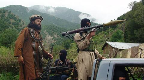 Pakistani Taliban patrol in their stronghold of Shawal in Pakistani tribal region of South Waziristan. (AP)
