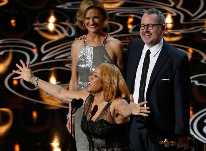 "Best Documentary Feature: 20 Feet from Stardom<br /><br /> Darlene Love sings as Morgan Neville looks on as they accept the Oscar for best documentary feature for ""20 Feet from Stardom"". (Reuters)"