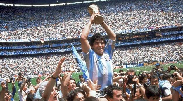 Maradona holds the hand of God