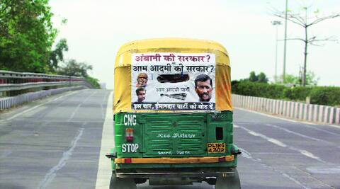 An AAP poster on an auto-rickshaw in the capital on Sunday. (Amit Mehra)