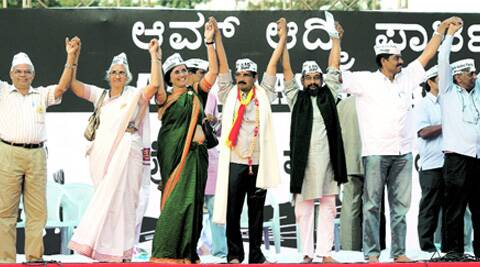 AAP leader Arvind Kejriwal with party candidates at a rally in Bangalore on Sunday. (PTI)