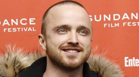 Aaron Paul says he had a weird experience at a party when he, Michael Jackson and the Prince of Brunei got drunk in a library bar. (Reuters)