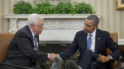 President Barack Obama shakes hands with Palestinian President Mahmoud Abbas during their meeting in White House, Washington,  March 17, 2014. (AP)