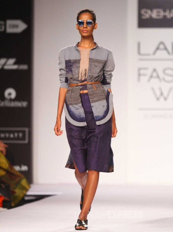 A models struts down the ramp in a tunic with a belted shirt. (IE Photo: Amit Chakravarty)