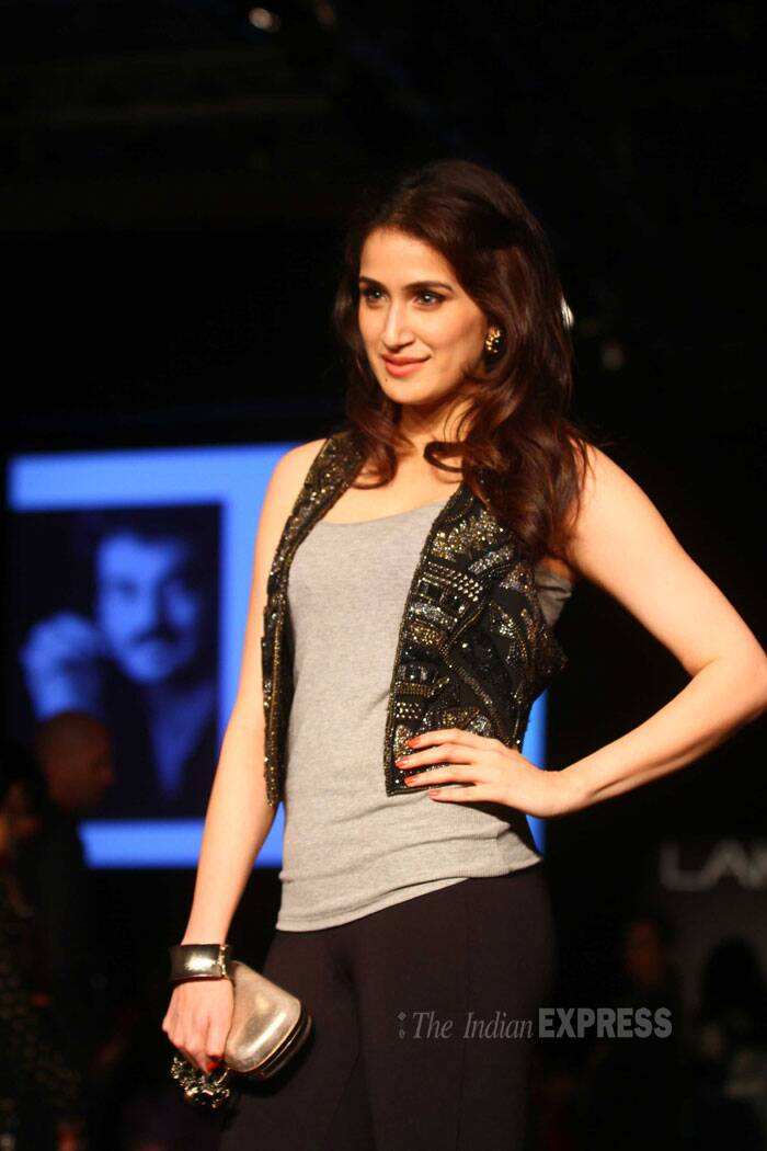 'Chak De! India' girl Sagarika Ghatge strikes a pose for the cameras in a grey tank top with a sleeveless jacket. (IE Photo: Amit Chakravarty)