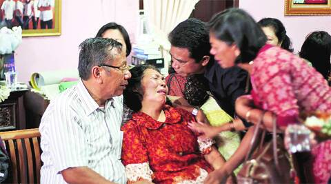 Family members comfort the parents of an Indonesian citizen aboard the flight. (AP)
