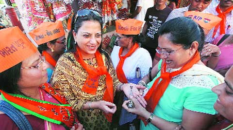 Party workers apply mehendi on the palm of BJP leader L K Advani's daughter Pratibha in Gandhinagar on Friday. (Javed Raja)