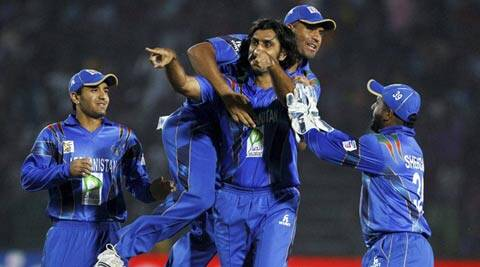 Afghanistan players celebrate the wicket of a Bangladesh batsman. Afghanistan won by 32 runs, their first win over an ICC full member (AP)