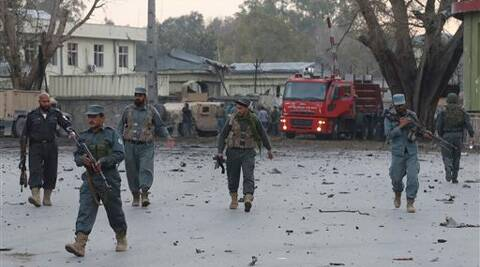 Afghan army and police gather around the area after an attack on a police station in Jalalabad. (AP)
