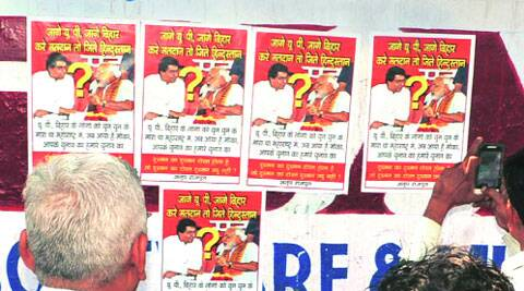 Posters showing Narendra Modi with Raj Thackeray on the walls in Pandesara area in Surat. Express